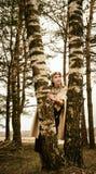 Mujer y hombre en la reconstrucción histórica del contexto étnico del traje Foto de archivo libre de regalías
