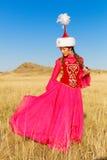Mujer y hombre hermosos del kazakh en traje nacional Foto de archivo