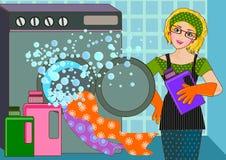 Mujer y lavadora Foto de archivo libre de regalías