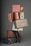 Mujer y maletas viejas Imágenes de archivo libres de regalías