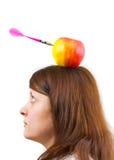 Mujer y manzana con la flecha Fotos de archivo libres de regalías