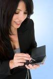 Mujer y organizador electrónico Fotos de archivo libres de regalías