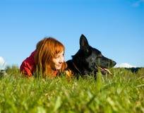Mujer y perro Imagen de archivo libre de regalías