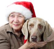 Mujer y perro hapy mayores Fotos de archivo libres de regalías