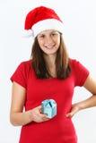 Mujer y regalo de la Navidad Imágenes de archivo libres de regalías