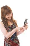 Mujer y smartphone Fotos de archivo libres de regalías