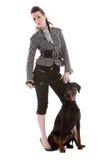 Mujer y su perro Foto de archivo libre de regalías