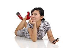 Mujer y teléfono Imágenes de archivo libres de regalías