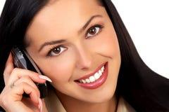 Mujer y teléfono móvil Fotografía de archivo libre de regalías