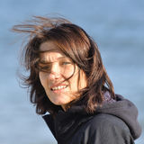 Mujer y viento Imagen de archivo