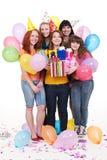 Mujeres alegres con los regalos y los globos Imagen de archivo libre de regalías
