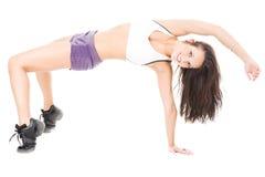 Mujeres atractivas jovenes que le muestran flexibilidad Fotos de archivo
