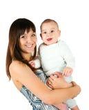 Mujeres bastante jovenes con su bebé Fotografía de archivo