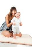 Mujeres bastante jovenes y su bebé Fotografía de archivo