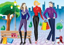 Mujeres con compras Imagen de archivo libre de regalías