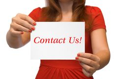Mujeres con el contacto de tarjeta nosotros Imágenes de archivo libres de regalías