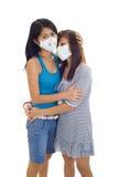 Mujeres con las máscaras protectoras Foto de archivo libre de regalías