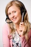 Mujeres con los auriculares Imágenes de archivo libres de regalías