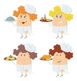 Mujeres de los cocineros con las bandejas fijadas Imágenes de archivo libres de regalías