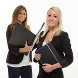 Mujeres de negocios con las listas imágenes de archivo libres de regalías