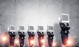 Mujeres de negocios con los monitores en vez de la cabeza Imagen de archivo