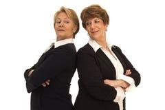 Mujeres de negocios rivales amistosas Foto de archivo libre de regalías