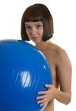 Mujeres descubiertas con la bola azul Fotos de archivo