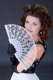 Mujeres elegantes con el ventilador Foto de archivo libre de regalías