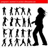 Mujeres embarazadas en vector de la silueta de la acción Foto de archivo libre de regalías