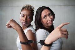 Mujeres enojadas en manillas Fotografía de archivo