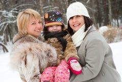 Mujeres felices con la hija Imágenes de archivo libres de regalías