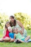 Mujeres felices con sus niños Imagen de archivo libre de regalías