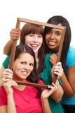 Mujeres felices en un marco vacío Imágenes de archivo libres de regalías