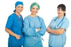 Mujeres felices y serias de los doctores Fotografía de archivo
