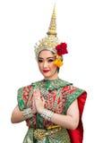 Mujeres hermosas de la demostración de Khon y traje tradicional Imagenes de archivo