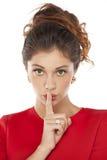 Mujeres jovenes con el finger en los labios Imágenes de archivo libres de regalías
