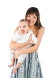 Mujeres jovenes con su bebé Imágenes de archivo libres de regalías