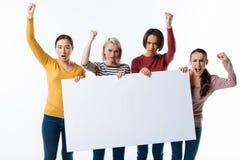 Mujeres jovenes enojadas que protegen sus derechas Foto de archivo libre de regalías