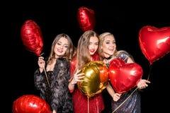 Mujeres magníficas con los globos Fotos de archivo