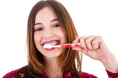 Mujeres que aplican sus dientes con brocha Fotografía de archivo libre de regalías