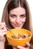 Mujeres que comen los cereales Foto de archivo libre de regalías