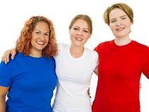 Mujeres que llevan las camisas en blanco blancas y rojas azules Imagen de archivo