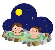 Mujeres que se bañan en aguas termales Imagen de archivo libre de regalías