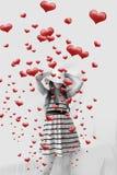 Mujeres y corazones que salen Foto de archivo libre de regalías