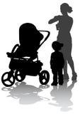 Mujeres y niño con el coche lateral Imagen de archivo libre de regalías