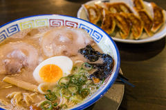Mukashi chashu ramen with boiled egg and gyoza. Stock Photo