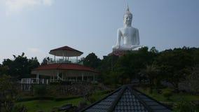 White buddha statue in Wat Roi Phra Phutthabat Phu Manorom in Mukdahan, Thailand. MUKDAHAN, THAILAND - OCTOBER 2 : Big white buddha statue in Wat Roi Phra stock video