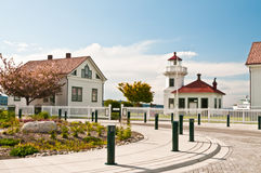 Mukilteo Light Station. Historic Pacific Northwest Mukilteo Light Station, including wooden lighthouse and station keeper quarters enclosed in white picket fence Stock Photo
