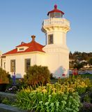Mukilteo white lighthouse building during sunset. Stock Photography