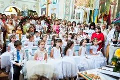 Mukyluntsi, de Oekraïne - 26 juni, 2016: Eerste heilige kerkgemeenschap Royalty-vrije Stock Afbeelding